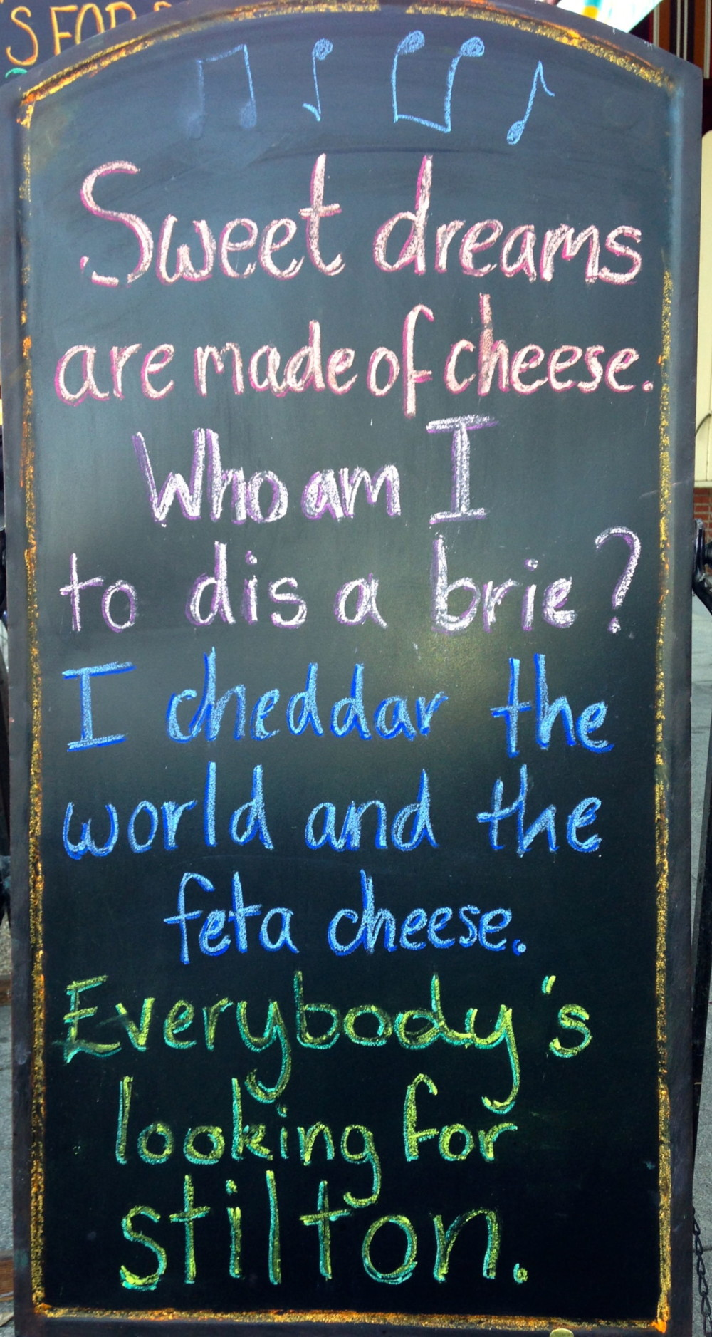 Say CHEESE!  This is the sign in front of the loveliest cheese shop.